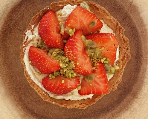 strawberry tart with passion fruit and a pistachio chantilly